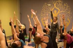 Annie Q teaching a yoga class