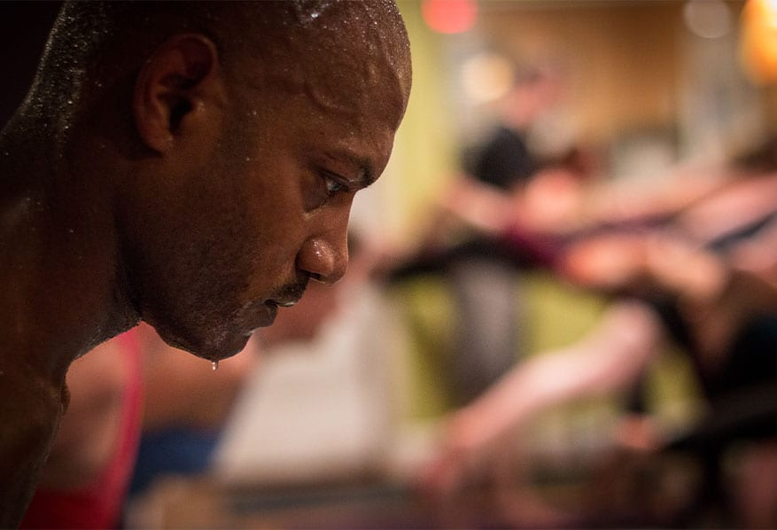 sweat dripping down a man's chin during yoga class